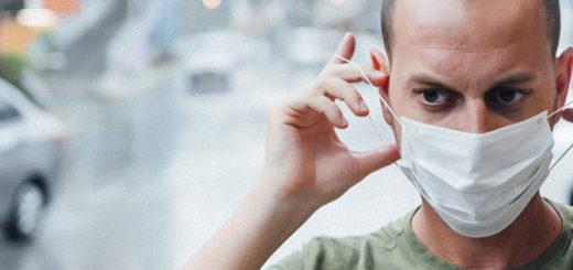 uomo con mascherina protocollo anti covid-19
